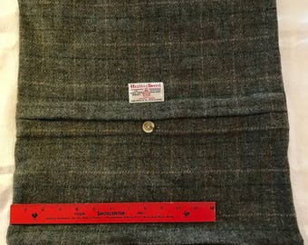 Harris tweed pillow cover with label and decorative button detail, zippered closure