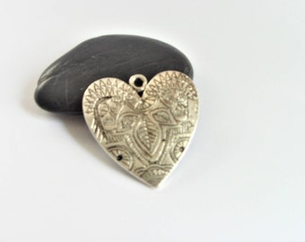 Antique patterned silver plated heart charm pendant.