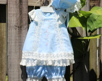 Dress for girl. With shorty knickers and soft blue hood embroidered by hand