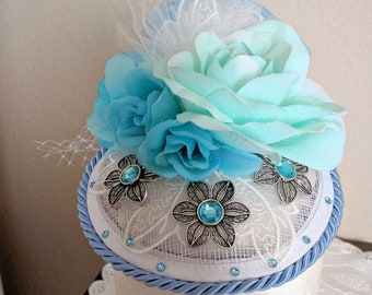 HatsByDesignByAdele.  White and blue fascinator hat.   This hat can go Casual or dressy.  Really beautiful!