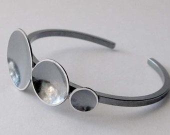 Oxidized sterling silver cuff bracelet.  Graduated disc trio. Modern rustic jewelry.  Ascending dark circles. Prenumbra. Urban gift for her