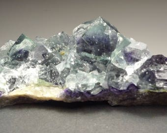 Green cubic fluorite with black fibrous boulangerite inclusion core from Inner Mongolia China B1891