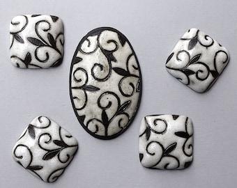 Arabesque - White on dark clay