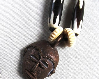 32 Inch Continuous Strand Necklace Batik Bone Chevron Design Tube Beads and Bronze Focal