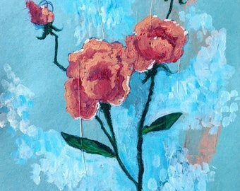 Roses on a blue paper - iridescent background.