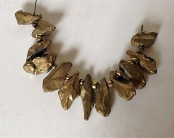 Gold titanium quartz pendant set. Rough stone gemstone pendant set