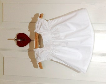 A sweet smocked blouse in white