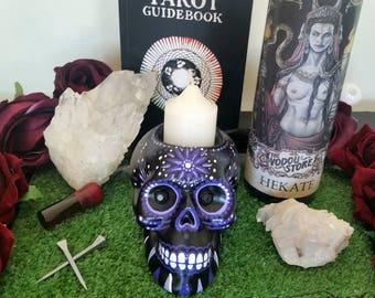 Hand painted dia de los muertos skull candle holder in purple tones