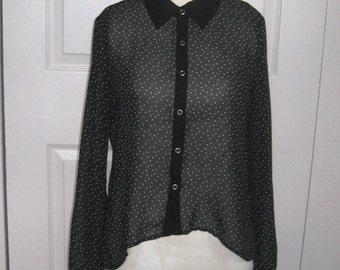 sheer blouse . sheer black blouse . polka dot blouse . high-low black blouse