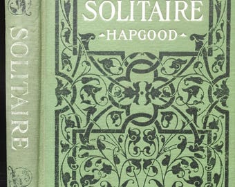 Antique book on solitaire card playing, 1908. Decorative Victorian binding, vintage green book with a cool vibe Great old games instructions