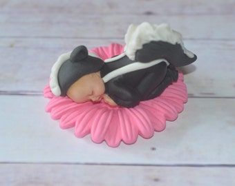 Baby skunk cake topper