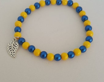 Pretty blue & yellow glass beads with cute leaf charm