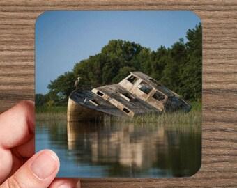 4 photos of a ship wreck coasters