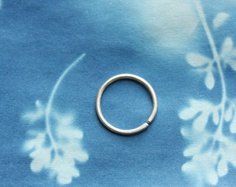 one sterling silver hoop //  single recycled 20g 9mm seamless + catchless ring // nose + ear + cartilage // woodsy cosmic bohemian