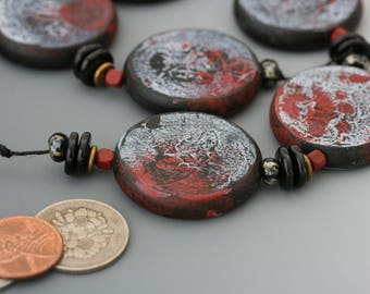 Blue, black, brick red coin beads. Rustic, organic, handcrafted focal beads. Wood base. Set of 6. Vintage plastic, wood, glass.