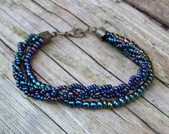 Rainbow braid stacking bracelet, Boho luxe beaded colorful petrol teal green violet navy braided jewelry, Multi strand multicolor bracelet