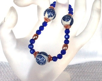 Cobalt Glass, Copper and  Porcelain Beads  Stretch Bracelet