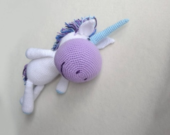 Handmade amigurumi unicorn, an excellent stuffed animal toy for children.