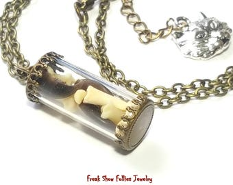 real raccoon bones and claws glass vial oddity necklace