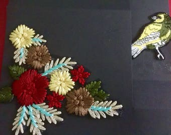 Embroidered flowers with curios bird