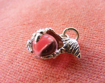 G) Vintage Sterling Silver Charm Pink orb in a dragons claw