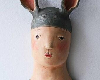 Hare Boy ceramic wall sculpture
