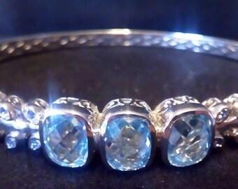 sterling silver bangle bracelet,platinum overlay,blue topaz, 7.15 carats.gift boxed