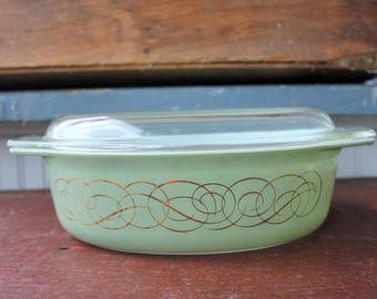Pyrex's Green Scroll or Golden Scroll Pattern. Rare Pyrex 1960's Olive Green Oval Casserole Dish with lif. 1 1/2 QT # 22
