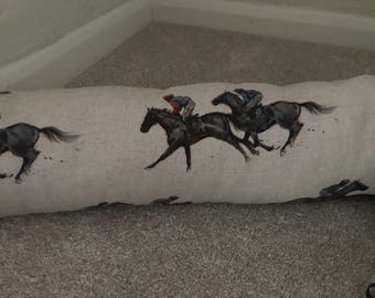 Handmade Draught Excluder in Soun country's racing fabric.
