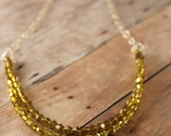 Yellow glass beaded double strand necklace with sterling silver chaining