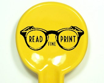 "spoon rest with ""Read Fine Print"" instruction, shown in Lemon Butter - Made to Order / Pick Your Colour"