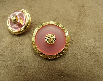 Acrylic button - gold on hot pink background