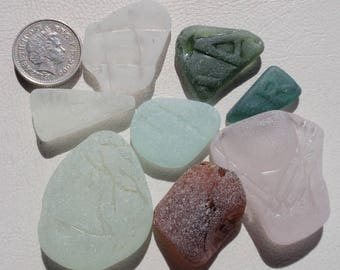 English sea glass patterned  an A ,H and R others  nicely patterned all colours
