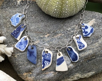 "Sea glass pottery jewelry- 9 pieces of blue sea glass pottery on a 18"" sterling silver necklace."