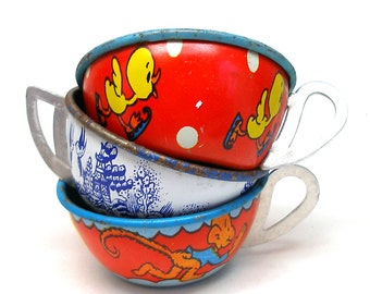 Tin Toy Tea Cups & Saucers, Set of 6 with birds, monkey, horse, ducklings.