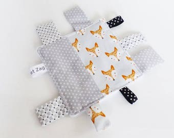 Taggy square fabric foxes and grey stars and white minkee back