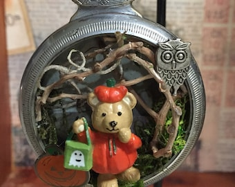 Halloween ornament in a vintage pocket watch