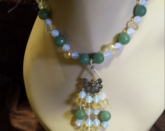 One strand beaded faceted jade, opulite, citrine necklace with center drops