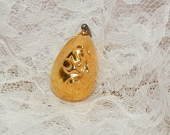 Gold tone Egg Shaped Pendant with Raised Design