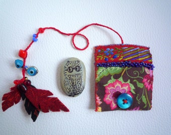 Lenny owl miniature totem  in  amulet bag pouch, art creature textile, illustration, painted stone pebble by Wassupbrothers