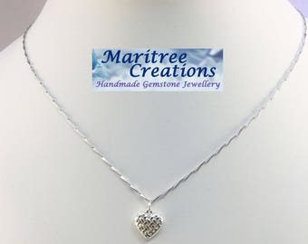"925 Sterling silver 18"" necklace with heart pendant."