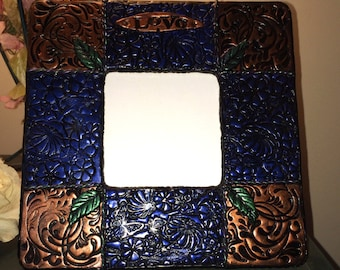 Picture frame. Hand made with US made polymer clay. One of a kind and signed by artist.