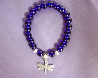 Royal blue stretch bracelet with dragonfly charm