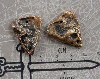 An pair of Bronze metal clay 'arrows'