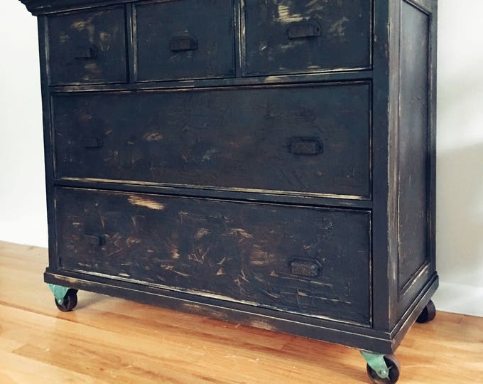 SOLD         ......Upcycled Pottery Barn industrial dresser caster wheels