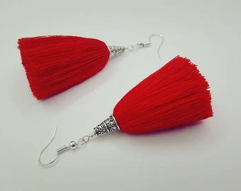 Red tassel earrings with silver tone caps