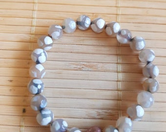 Fancy dotted agate with copper heart bead