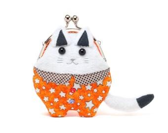 Descartes, the philosopher cat dressed in orange