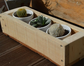 Garden planting, cache pot in recycled wood
