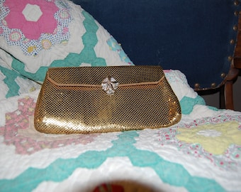 Gold Evening Purse with a Jeweled Closure